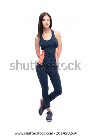 Full length portrait of a pretty fitness woman standing isolated on a white background. Looking camera