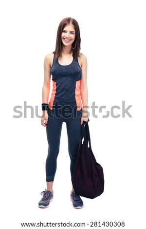 Full length portrait of a pretty woman standing with sports bag isolated on a white background. Looking at camera - stock photo