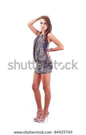 Full length portrait of a pretty young woman posing over white background - stock photo