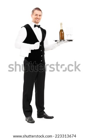 Full length portrait of a professional waiter holding a tray with a champagne and two glasses on it isolated on white background - stock photo
