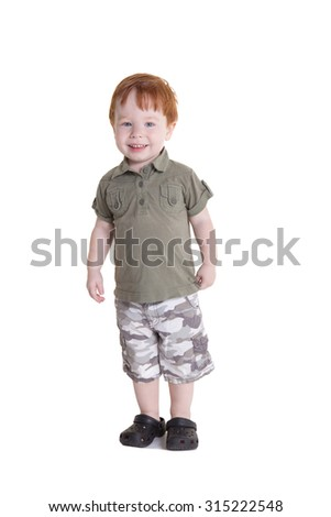 Full length portrait of a red head toddler isolated on white - stock photo