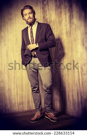 Full length portrait of a respectable handsome man in a suit. Men's fashion. - stock photo