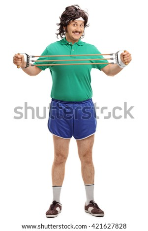 Full length portrait of a retro guy exercising with retro equipment isolated on white background - stock photo