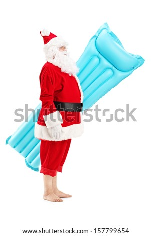 Full length portrait of a Santa claus holding a swimming mattress on vacation, isolated on white background - stock photo