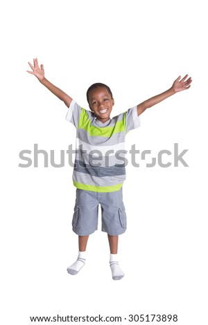 Full length portrait of a school aged boys with his arms in the air