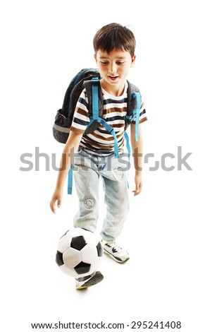 Full length portrait of a schoolboy with a soccer ball. Isolated on white background - stock photo