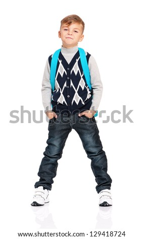 Full length portrait of a schoolboy with backpack isolated on white background