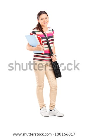 Full length portrait of a schoolgirl holding notebooks isolated on white background