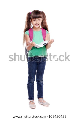 Full length portrait of a schoolgirl holding the book on white background - stock photo
