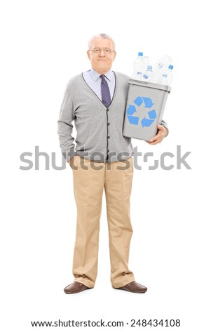 Full length portrait of a senior gentleman holding a recycle bin isolated on white background - stock photo