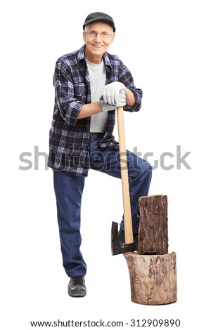 Full length portrait of a senior gentleman posing next to a small log and leaning on an axe isolated on white background - stock photo