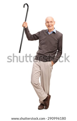 Full length portrait of a senior gentleman showing his cane and leaning against a wall isolated on white background - stock photo