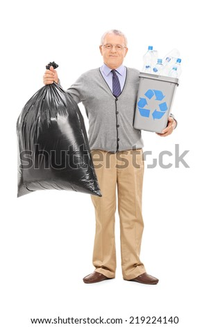 Full length portrait of a senior holding a recycle bin and a garbage bag isolated on white background - stock photo