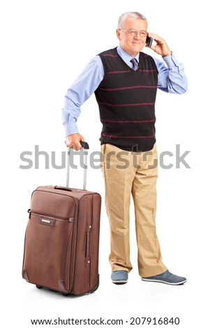 Full length portrait of a senior man carrying a bag and talking on phone isolated on white background - stock photo
