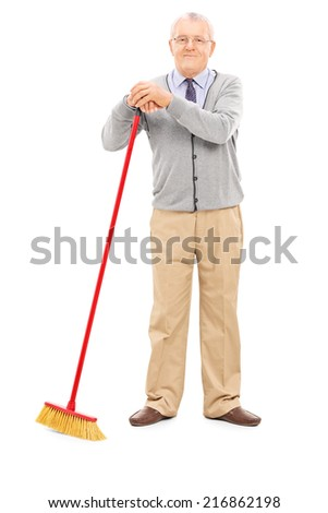 Full length portrait of a senior man holding a broom isolated on white background - stock photo