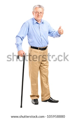 Full length portrait of a senior man holding a cane and giving thumb up isolated on white background