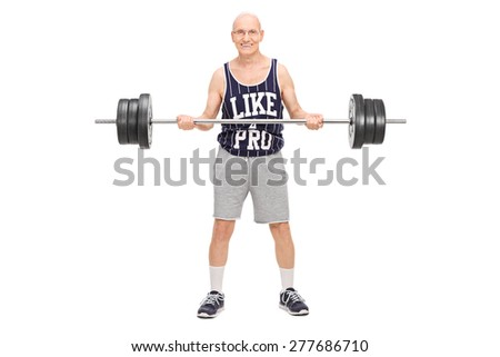 Full length portrait of a senior man in a dark blue jersey, exercising with a barbell and looking at the camera isolated on white background - stock photo