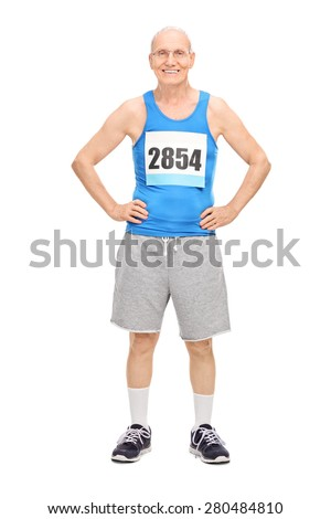 Full length portrait of a senior man in sportswear smiling and looking at the camera isolated on white background - stock photo