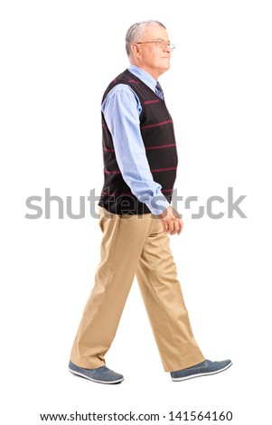Full length portrait of a senior man walking isolated on white background - stock photo