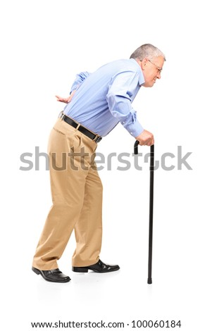 Full length portrait of a senior man walking with cane isolated on white background - stock photo