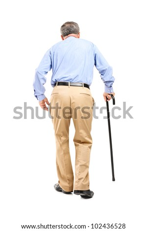 Full length portrait of a senior man with cane walking isolated on white background - stock photo