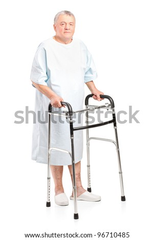 Full length portrait of a senior patient using a walker isolated on white background - stock photo