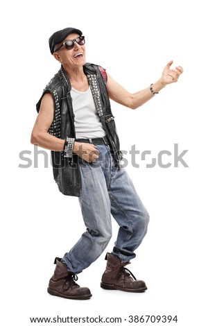 Full length portrait of a senior punk rocker playing air guitar isolated on white background