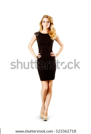 Full Length Portrait of a Sexy Blonde Woman in Little Black Fashion Dress with Hands on Hips. Isolated on White.