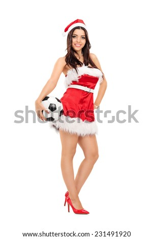 Full length portrait of a sexy female in Santa costume holding a football isolated on white background - stock photo