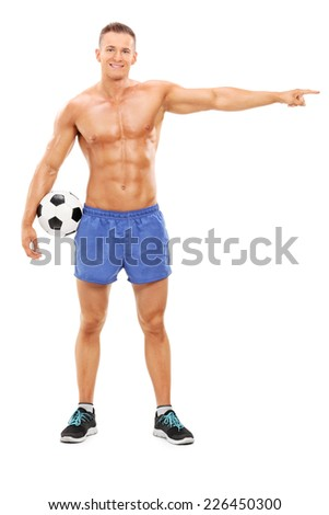 Full length portrait of a shirtless football player pointing with hand isolated on white background - stock photo