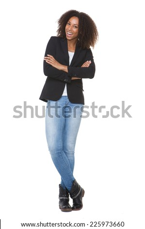 Full length portrait of a smiling african american woman with arms crossed posing on isolated white background - stock photo