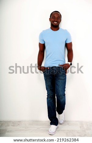 Full length portrait of a smiling african man  - stock photo