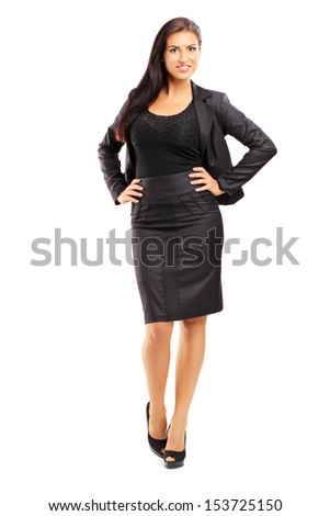 Full length portrait of a smiling beautiful woman in suit posing isolated on white background