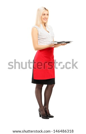 Full length portrait of a smiling blond female waitress holding a tray isolated on white background - stock photo