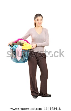 Full length portrait of a smiling female holding a laundry basket isolated on white background - stock photo