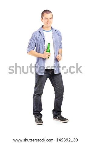 Full length portrait of a smiling guy holding a beer bottle isolated on white background - stock photo