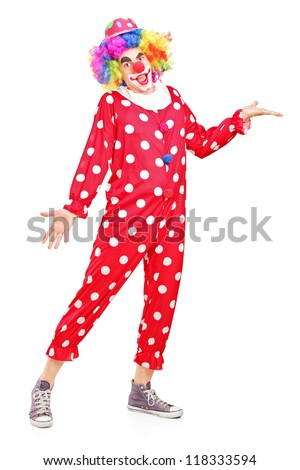 Full length portrait of a smiling happy clown gesturing isolated on white background - stock photo