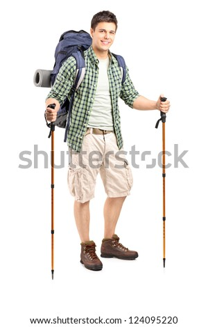 Full length portrait of a smiling hiker with backpack and hiking poles posing isolated on white background - stock photo