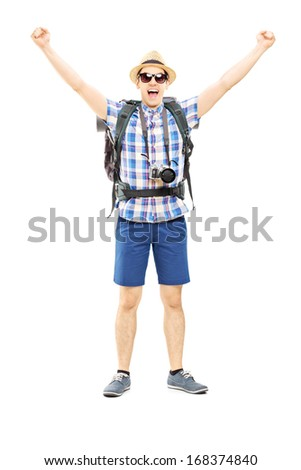 Full length portrait of a smiling male hiker with raised hands gesturing happiness isolated on white background - stock photo