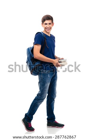 Full length portrait of a smiling male student holding books isolated on a white background