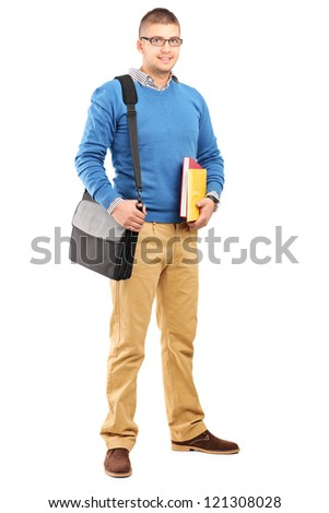 Full length portrait of a smiling male student with shoulder bag holding notebooks isolated on white background
