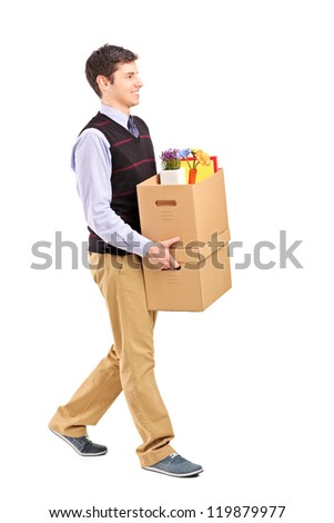 Full length portrait of a smiling male walking with boxes, moving into a new home isolated on white background