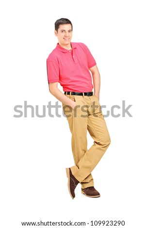 Full length portrait of a smiling man leaning against wall, isolated on white background - stock photo