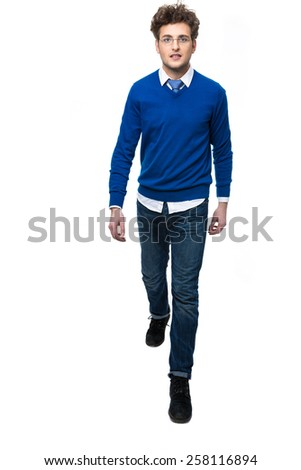 Full length portrait of a smiling man walking over white background - stock photo