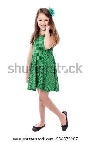 Full length portrait of a smiling pretty little girl isolated over white background