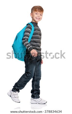 Full length portrait of a smiling schoolboy with backpack, isolated on white background