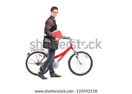Full length portrait of a smiling student holding books and pushing his bike isolated on white background - stock photo
