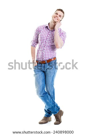 Full length portrait of a smiling student talking on a phone isolated on white background  - stock photo