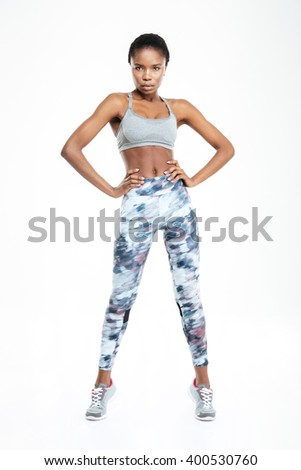 Full length portrait of a sports afro american woman standing isolated on a white background - stock photo