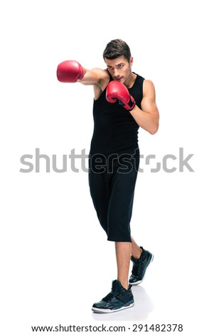 Full length portrait of a sports man boxing in red gloves isolated on a white background - stock photo